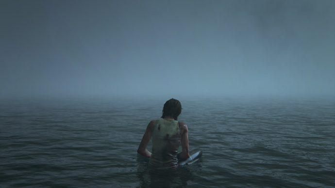 The Last of Us Parte II: Ellie sentada no raso da praia em Santa Barbara, segurando sua mão que sangra