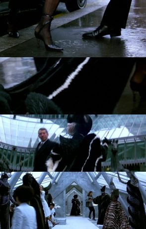 Montagem com trechos da apresentação de Cruella: plano detalhe de um pé saindo de um carro, plano aproximado de alguém andando na rua, Alguém de costas caminha, Glenn Close entra no que parece ser um atelier.